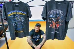 Vinny Ferraro, owner of Born Dead Clothing company, with some of the t-shirts with his artwork at his business location on Monday, Oct. 11, 2021, in Fort Edward, N.Y.