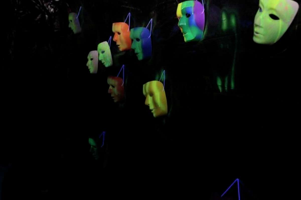 Masks hang in the hallway of the 2018 haunted hatchery event in Paris Park. (Pioneer photos/Meghan Gunther-Haas)