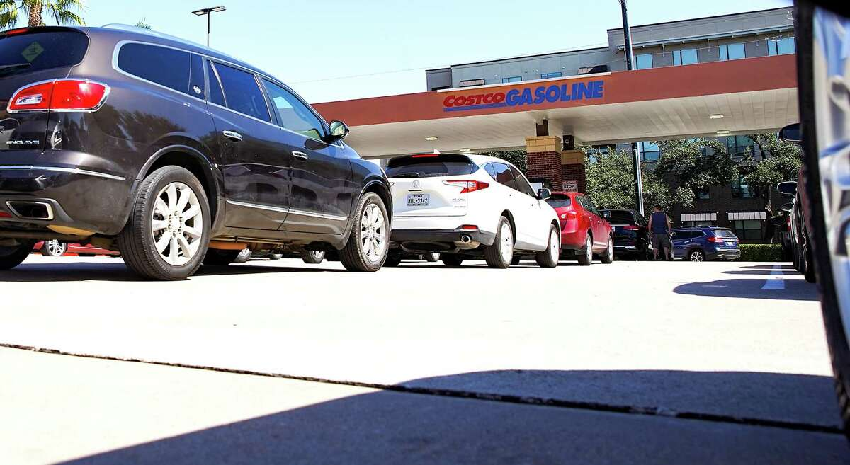 Cars line up for gas in Houston on Monday, Oct. 11, 2021. Oil prices jump over $80 a barrel for the first time since 2014.