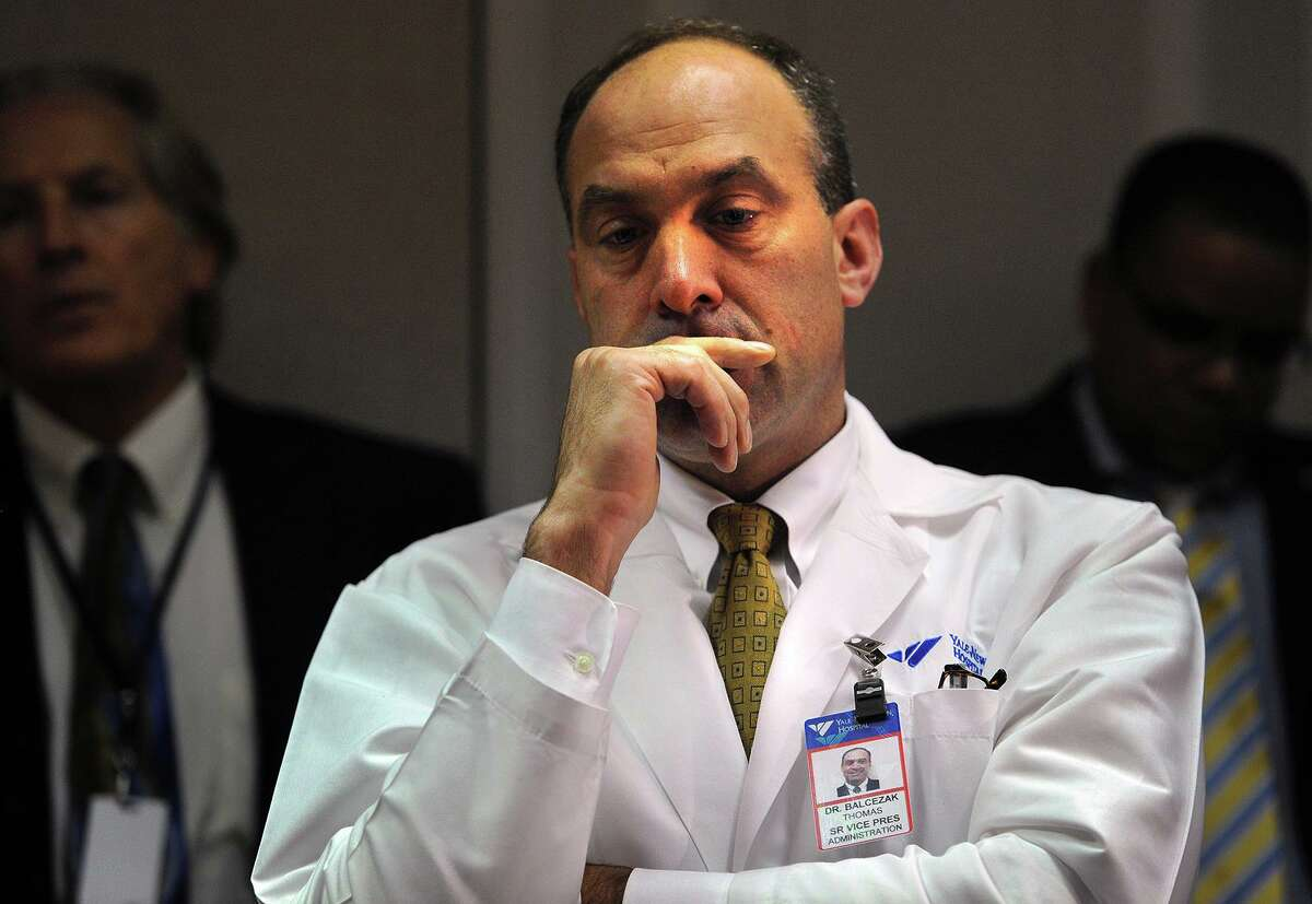 Dr. Thomas Balcezak, chief medical officer at Yale New Haven Hospital, looks contemplative before discussing the treatment of a current patient being evaluated for Ebola symptoms, in New Haven, Conn. on Thursday, October 16, 2014. Officials said they should receive results from a Massachusetts lab within 24 hours.
