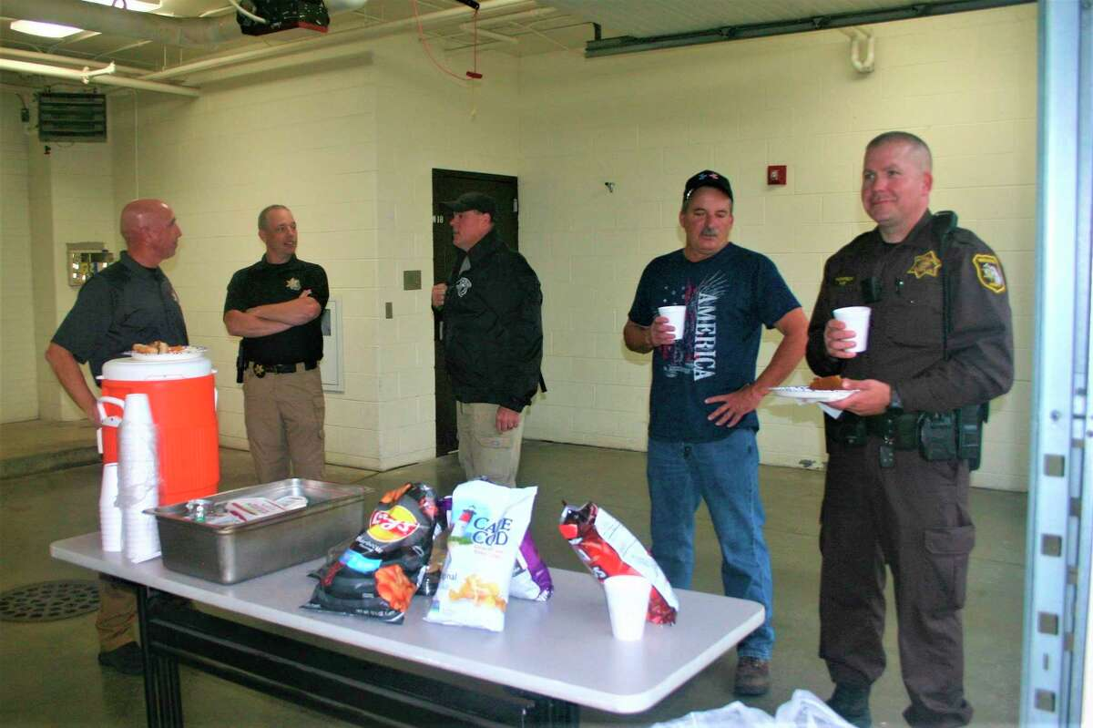 Mecosta County Sheriff Brian Miller visits with other employees of the sheriff's department during the employee appreciation lunch Friday. (Pioneer photo/Cathie Crew)