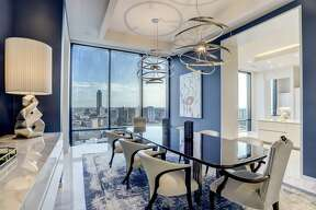 The dining room features Calacutta gold marble floors and a view of the Williams Tower.