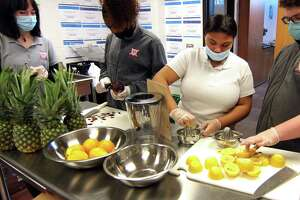 Wright Tech School student Tamara Hamilton, second from right, helps to make lemonade at The Wright Bean, a beverage program which operates every Friday at the school in Stamford. The program, which is part of the Hospitality Tourism & Guest Services, was launched in March of 2021, and provides students with hands on experience making and serving smoothies, milkshakes, as well as coffee and tea beverages.