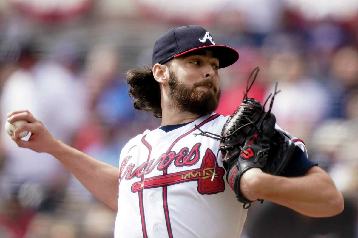 Atlanta Braves starting pitcher Ian Anderson works against the Milwaukee Brewers during the first inning of Game 3 of their National League Division Series on Monday, Oct. 11, 2021, in Atlanta.