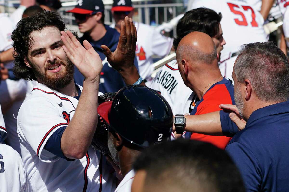 Atlanta Braves starting pitcher Ian Anderson celebrates in the dugout after finishing the fifth inning of Game 3 against the Milwaukee Brewers on Monday, Oct. 11, 2021.