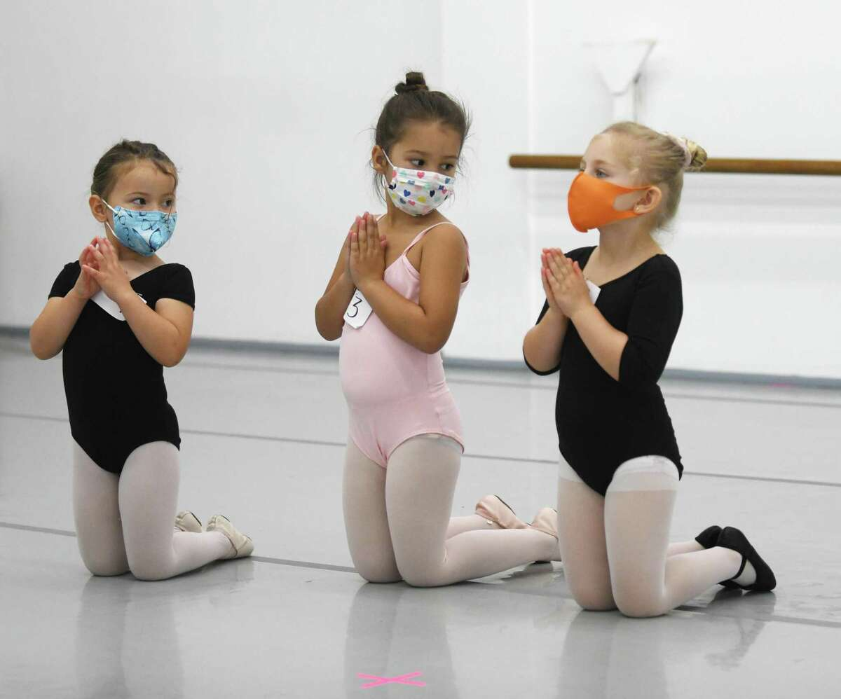 """Four-year-olds Isla McBeth, left, Karina Michalczyk, center, and Sophie Micewicz audition for """"The Nutcracker"""" at Connecticut Ballet in Stamford, Conn. Sunday, Oct. 10, 2021. After a two year hiatus due to COVID, """"The Nutcracker"""" will return this year with performances on Dec. 18 and 19 at The Palace in Stamford."""