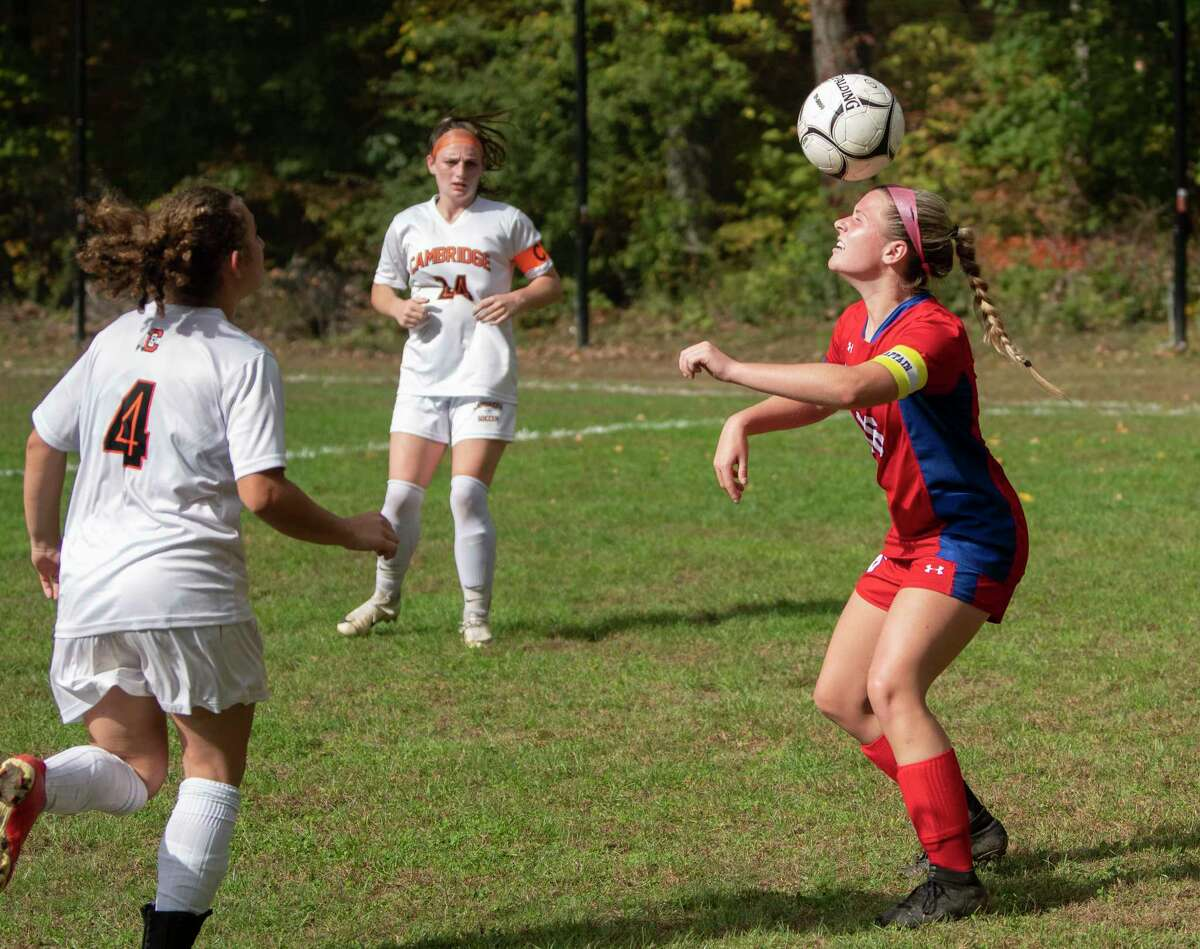 Maple Hill's Alayna Fletcher, right, heads the ball during a soccer game against Cambridge on Monday, Oct, 11, 2021 in Schodack, N.Y.