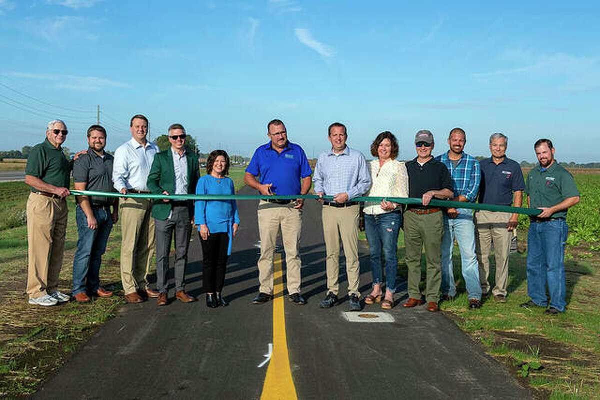 From left, former MCT Managing Director Jerry Kane, Phillip Jones of Oates Associates, Madison County Administrator Dave Tanzyus, MCT Managing Director SJ Morrison, Madison County Board member Stacey Pace, Troy Mayor Dave Nonn, MCT Board Members Allen Adomite and Kelly Schmidt, MCT Board Chairman Ron Jedda, Jason Govreau of Keller Construction, MCT Director of Engineering Mark Steyer and MCT Assistant Project Manager Jon Martin.