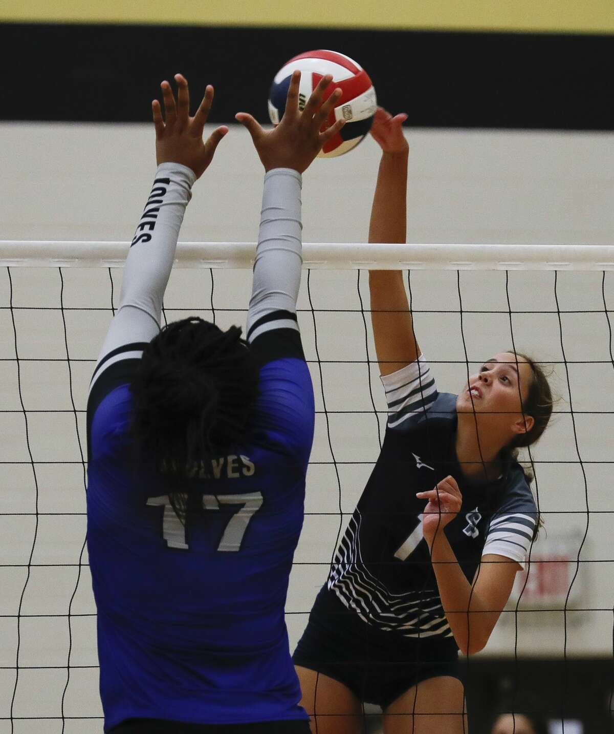 College Park's Paige Palmer (1) gets a shot off during a high school volleyball tournament at Cedar Park High School, Thursday, Aug. 12, 2021, in Cypress.