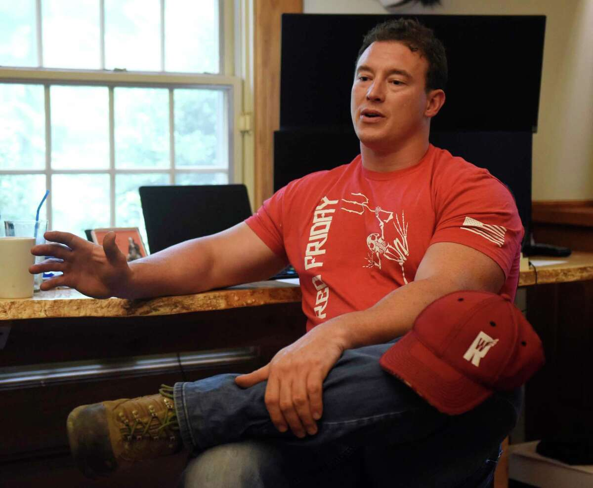 Former Navy SEAL Carl Higbie chats at his home in 2019. Higbie. a member of the Representative Town Meeting, is introducing a proposed ordinance that would remove the state's mask mandate for public and private schools. But there is no determination whether the RTM has the power to do that.