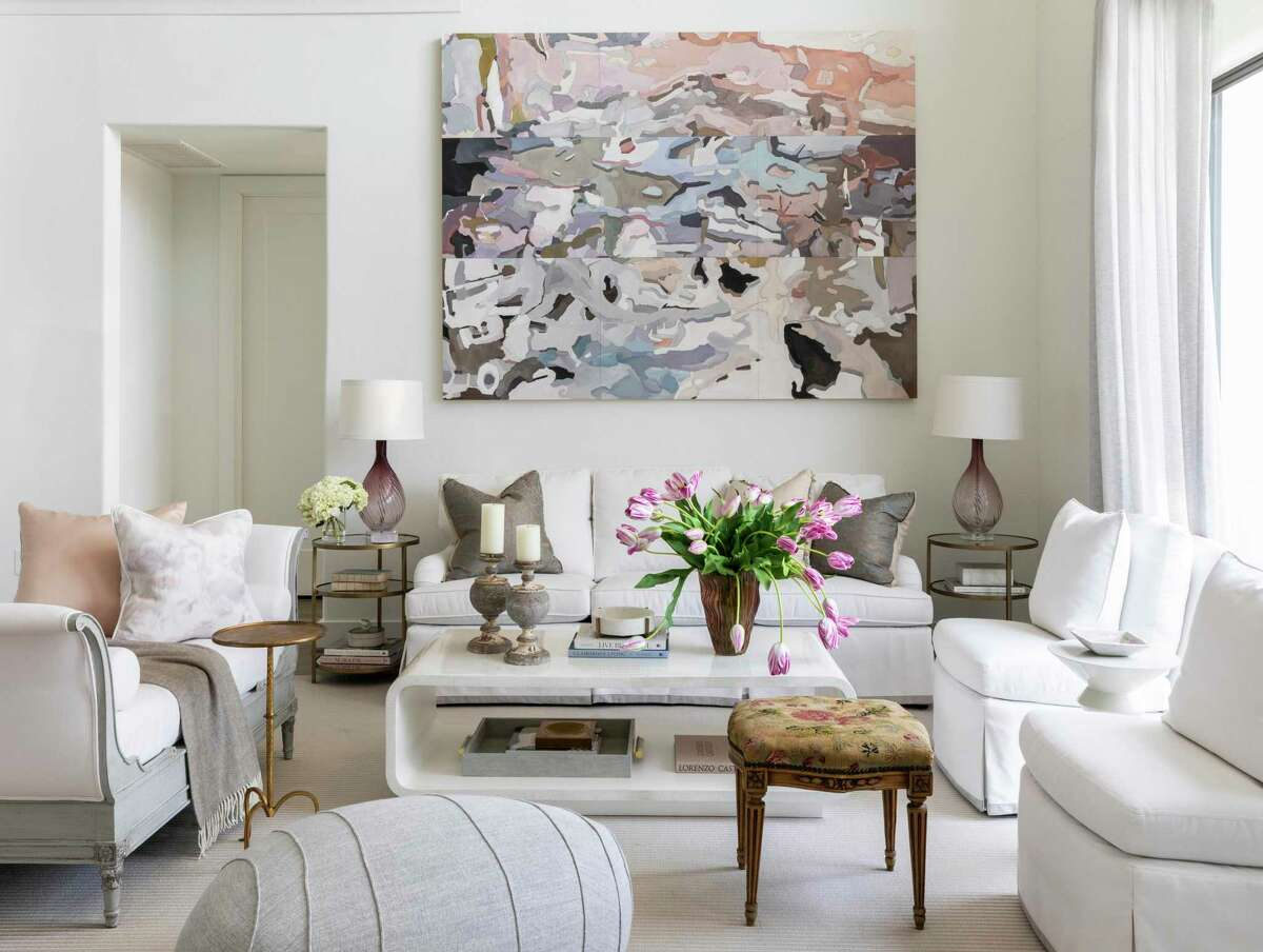 The all-white palette in the living room means Pramudji can move the furniture around.