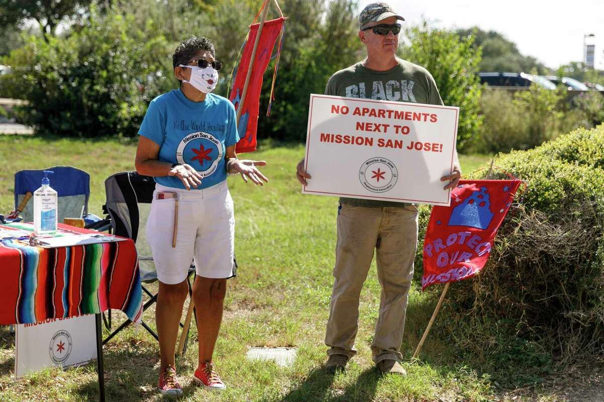 """Blanca Wilkins, left, and Brady Alexander explain why they are gathering signatures for a petition """"to protect the Missions from over-development."""""""