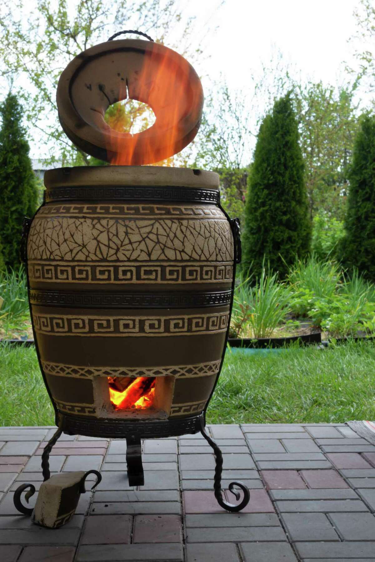 A tandoor is a cylindrical oven popular in Indian cooking. Typically made with clay or metal, tandoor ovens can easily get to temperatures that exceed 800 degrees with charcoal or firewood as the fuel. They date back more than 5,000 years to what's now the Punjab region of India.