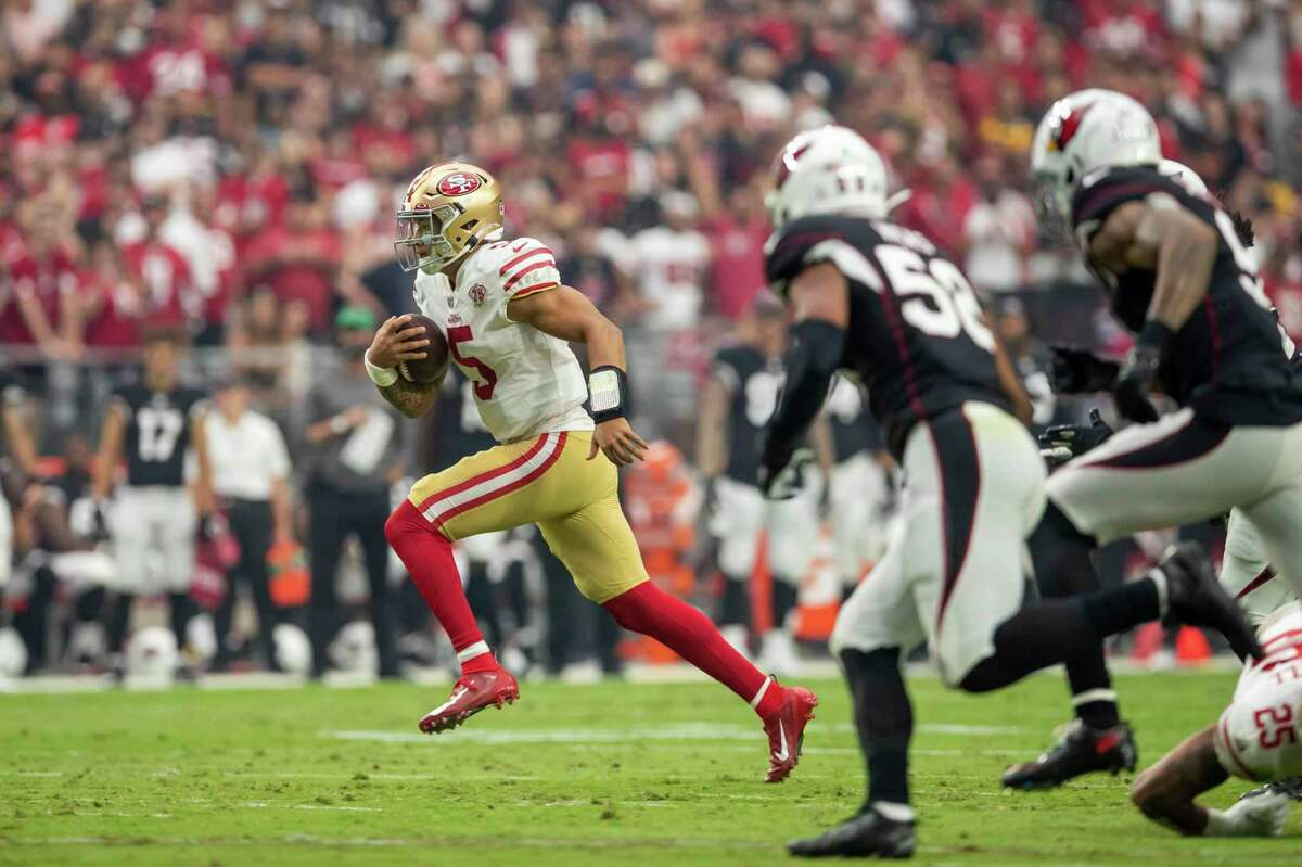 Quarterback (5) Trey Lance of the San Francisco 49ers scrambles against the Arizona Cardinals in an NFL football game, Sunday, Oct. 10, 2021, in Glendale, Ariz. The Cardinals defeated the 49ers 17-10. (AP Photo/Jeff Lewis)