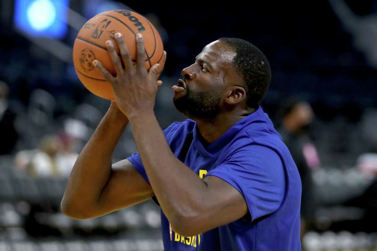 Golden State Warriors forward Draymond Green (23) warms up for a preseason NBA basketball game against the Los Angeles Lakers in San Francisco, Friday, Oct. 8, 2021. (AP Photo/Scot Tucker)