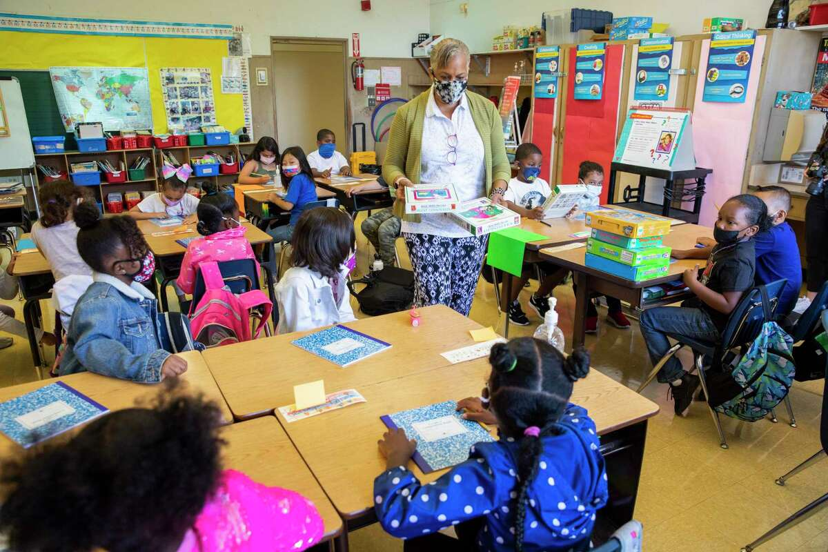 Joy Harrison teaches second grade in August at Carl B. Munck Elementary School in Oakland. Unvaccinated children under 12 face risks.