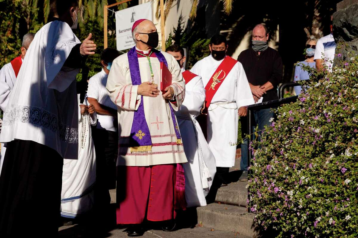 San Francisco's Archbishop Salvatore Joseph Cordileone (second from left) arrives to conduct an exorcism outside of Church of St. Raphael last October on the spot where a statue of St. Junipero Serra was toppled during a protest.