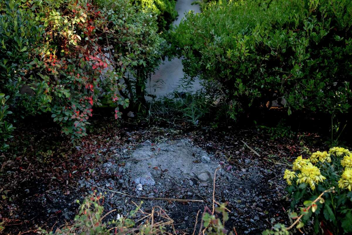 Debris sits on the site where the statue of St. Junipero Serra once stood before San Francisco's Archbishop Salvatore Joseph Cordileone conducts an exorcism outside of Church of Saint Raphael in San Rafael last October.