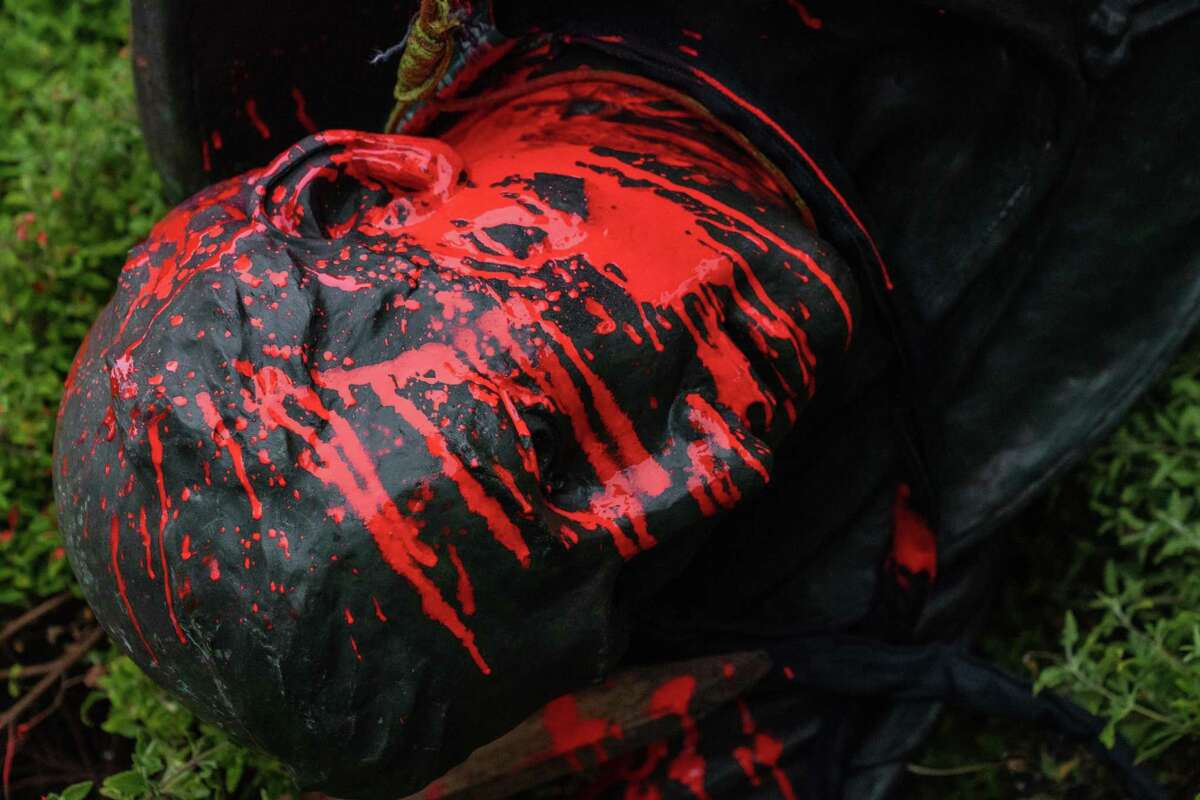 The statue of Junipero Serra is covered in red paint after protesters pulled it to the ground in Golden Gate Park in San Francisco on June 19, 2020.