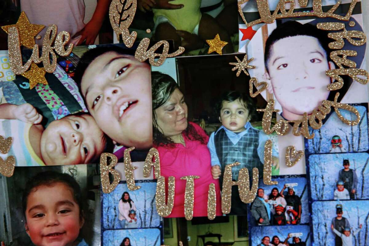 Photos of Maria Castañeda's children are arranged in a collage on the wall inside her tiny home at Casitas de Esperanza in San Jose.