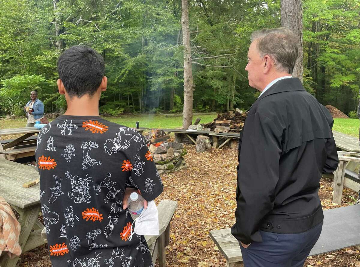 Gov. Ned Lamont made a visit last week to The Wilderness School, a program run by the state Department of Children and Families in East Hartland to help youths who are either in the criminal justice system or have suffered trauma that leaves them at risk. Lamont is pictured with a 17-year-old from the Hartford area in gathering area at the outdoor school.