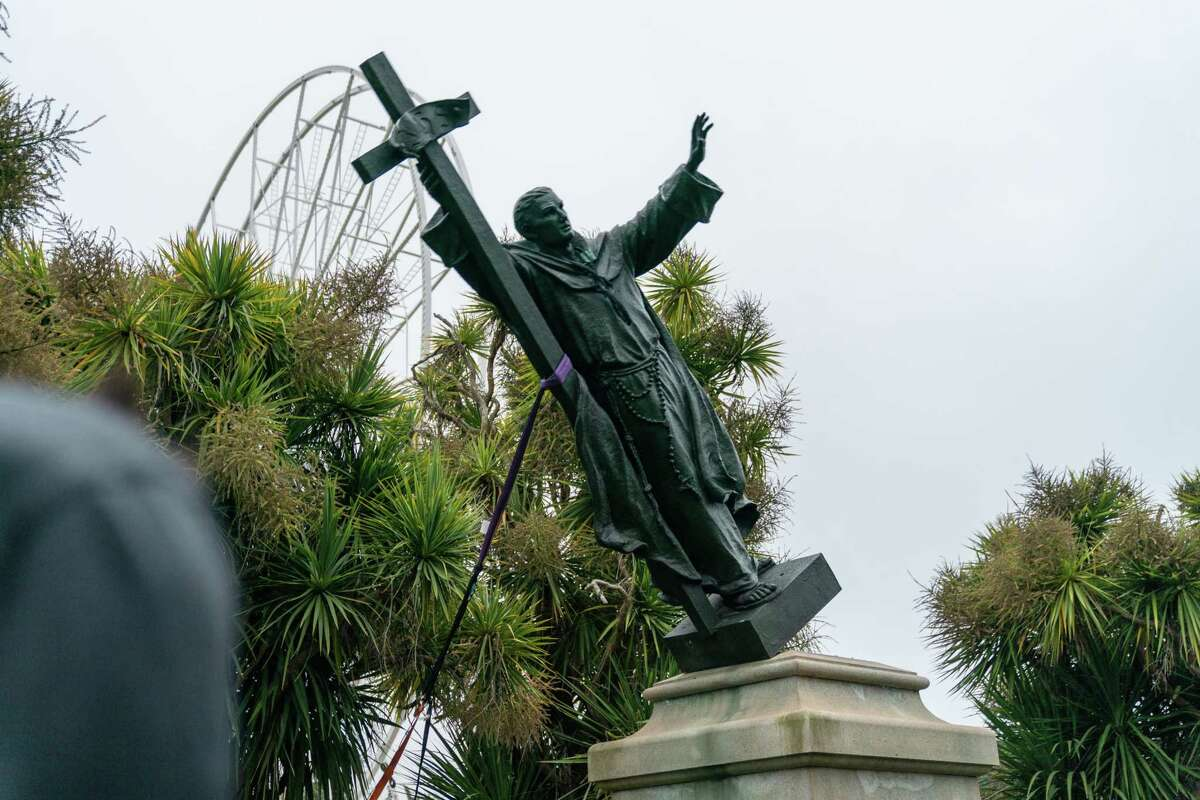 A statue of Junipero Serra is pulled to the ground by protesters in Golden Gate Park on June 19, 2020.