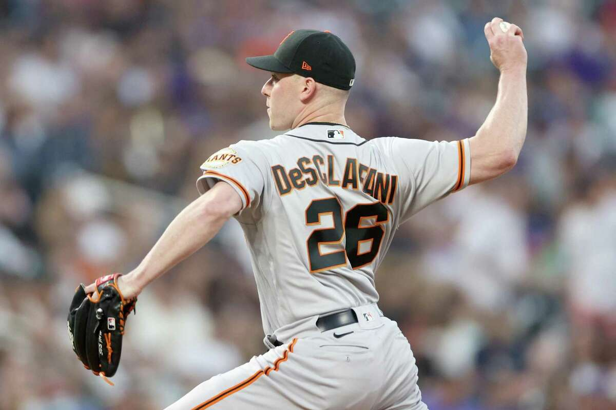 DENVER, COLORADO - SEPTEMBER 25: Starting pitcher Anthony DeSclafani #26 of the San Francisco Giants throws against the Colorado Rockies in the first inning at Coors Field on September 25, 2021 in Denver, Colorado. (Photo by Matthew Stockman/Getty Images)