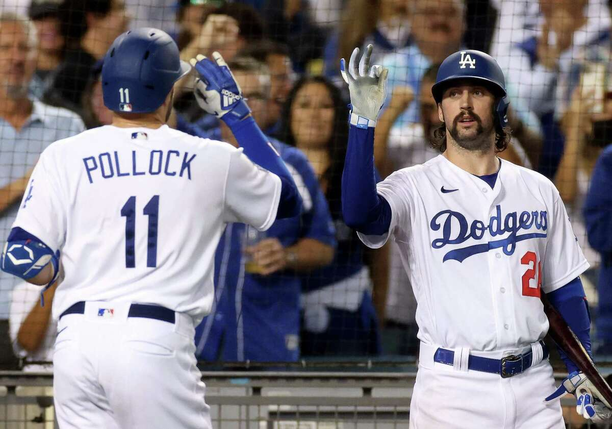 LOS ANGELES, CALIFORNIA - SEPTEMBER 30: Tony Gonsolin #26 of the Los Angeles Dodgers celebrates the homerun of AJ Pollock #11, to take a 4-1 lead over the San Diego Padres, during the fourth inning at Dodger Stadium on September 30, 2021 in Los Angeles, California. (Photo by Harry How/Getty Images)