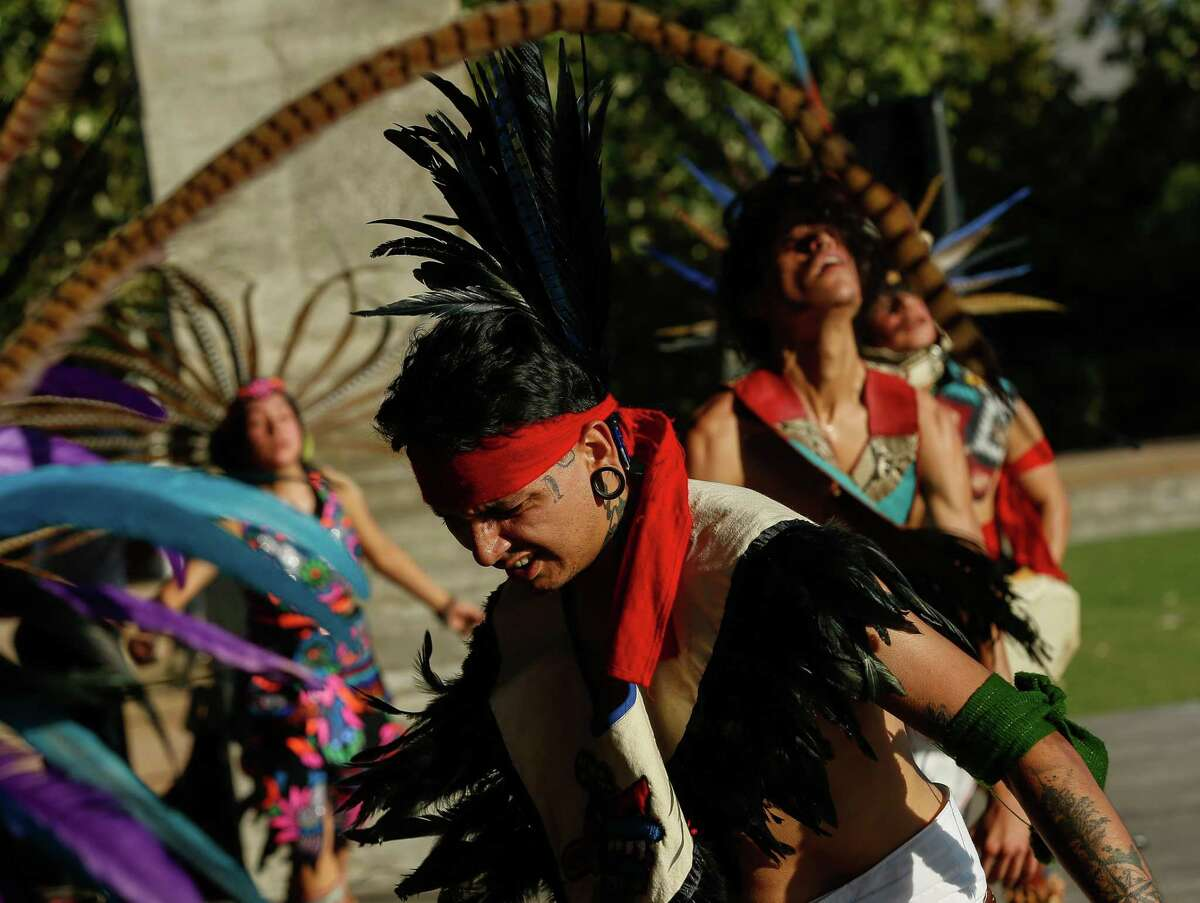 Estevan Chavez and his fellow members of Calmecac Tonantzin Yolilitzyotl performed a Mexicayotl dance at Buffalo Bayou Park for Indigenous People's Day, on Monday, Oct. 11, 2021, in Houston.