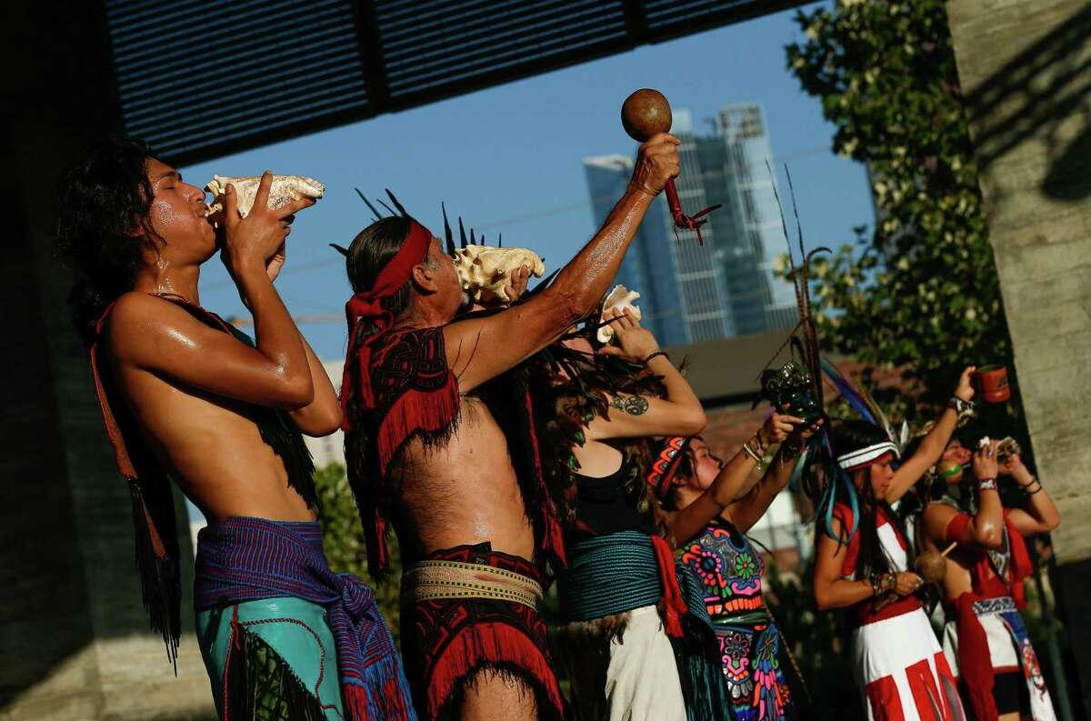 Members of Calmecac Tonantzin Yolilitzyotl performed a Mexicayotl dance at Buffalo Bayou Park for Indigenous People's Day, on Monday, Oct. 11, 2021, in Houston.
