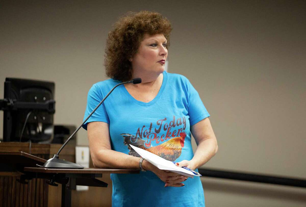 Katherine Herrin-Keith, who currently doesn't have any chickens, speaks her concerns on the city's chicken ordinance draft and supports people to have backyard chickens during a La Marque City Council meeting Monday, Oct. 11, 2021, in La Marque. The city council has been holding community meetings to discuss a proposed chicken ordinance. There's been an ongoing debate between people who keep backyard chickens and those who resent the clucking birds at the La Marque City Council meetings.