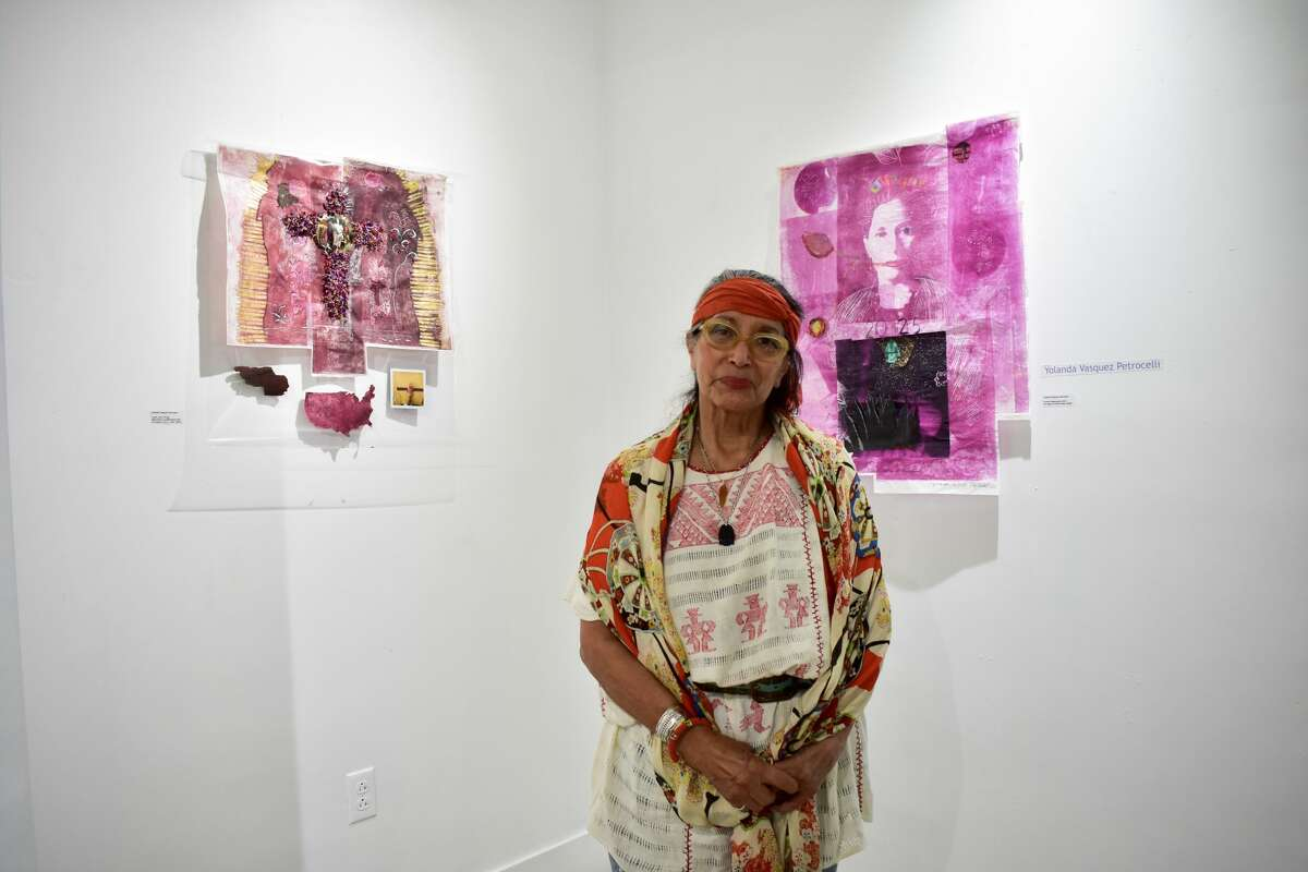 Bridgeport artist Yolanda Vasquez Petrocelli in the City Lights gallery located in Bridgeport on Oct. 8. The Latinisiimo exhibit showcases artists such as Carlos Bautista Biernnay, Carlos Hernández Chavez and Blanca Ameskua and will be on view until Nov. 3.