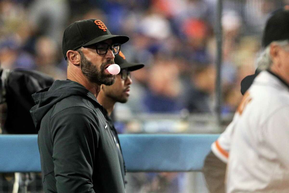 San Francisco Giants manager Gabe Kapler watches the action from the dugout as the San Francisco Giants played the Los Angeles Dodgers in Game 3 of the National League Division Series at Dodger Stadium in Los Angeles, Calif. on Monday, Oct. 11, 2021.