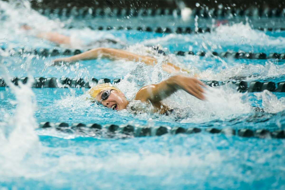 Dow High's Ella Roberson competes in the 400 free relay during a Nov. 23, 2019 state final.