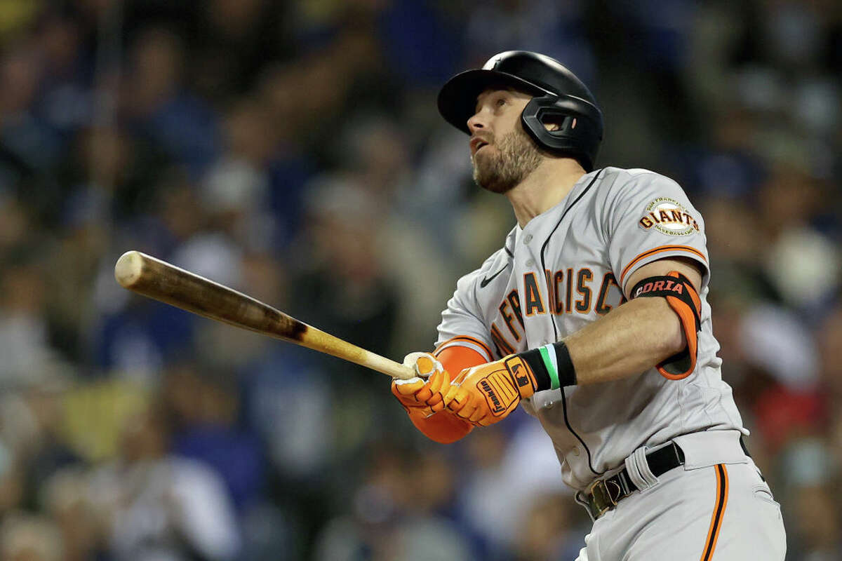 Evan Longoria of the San Francisco Giants watches his solo home run against the Los Angeles Dodgers during the fifth inning in Game 3 of the National League Division Series at Dodger Stadium on October 11, 2021 in Los Angeles, California.