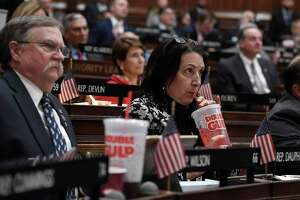 State Rep. Anne Dauphinais R-Killingly, takes a sip from a big gulp soda as Connecticut Gov. Ned Lamont delivers his budget address at the State Capitol in 2019. Lamont had proposed a tax on sugary drinks.