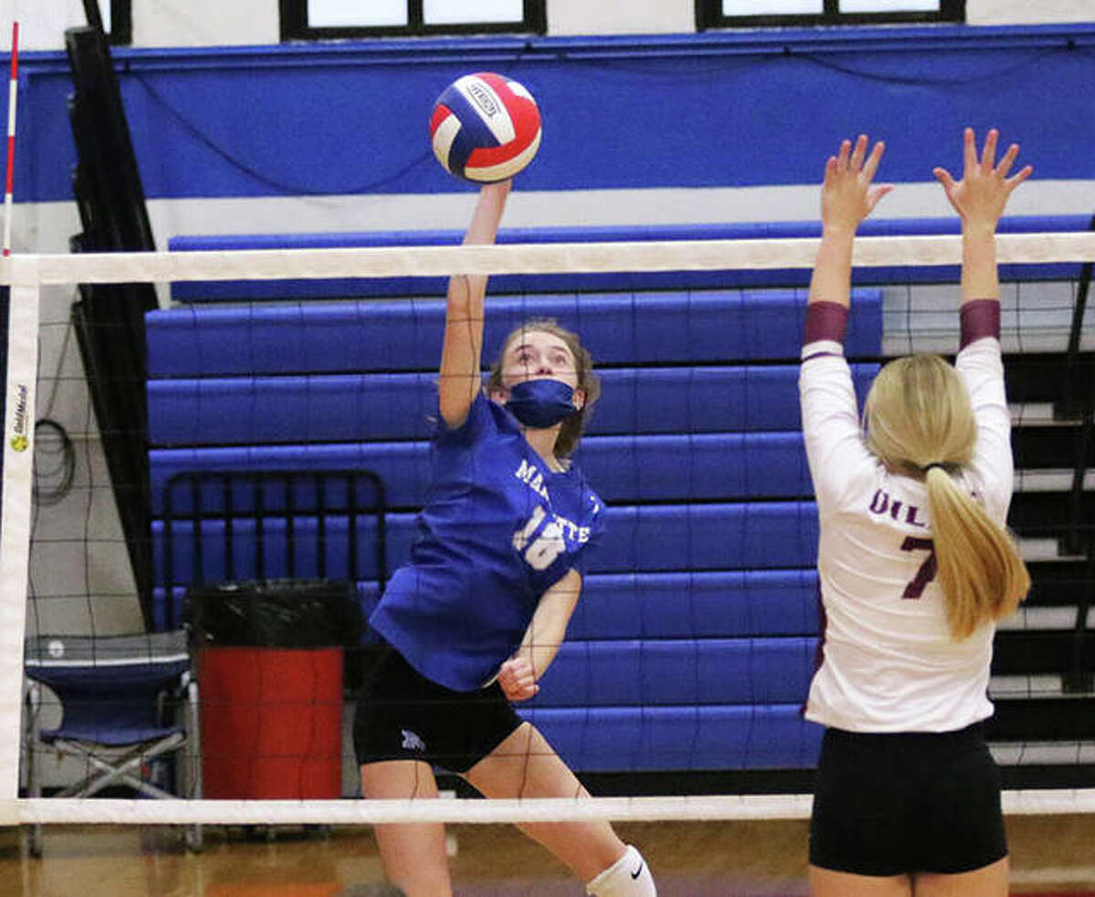 Marquette Catholic senior Natalie Wills (left) attacks during a match against EA-WR in the Roxana Tourney on Aug. 23. The Explorers were at home Monday night and defeated Okawville in three sets in Alton.