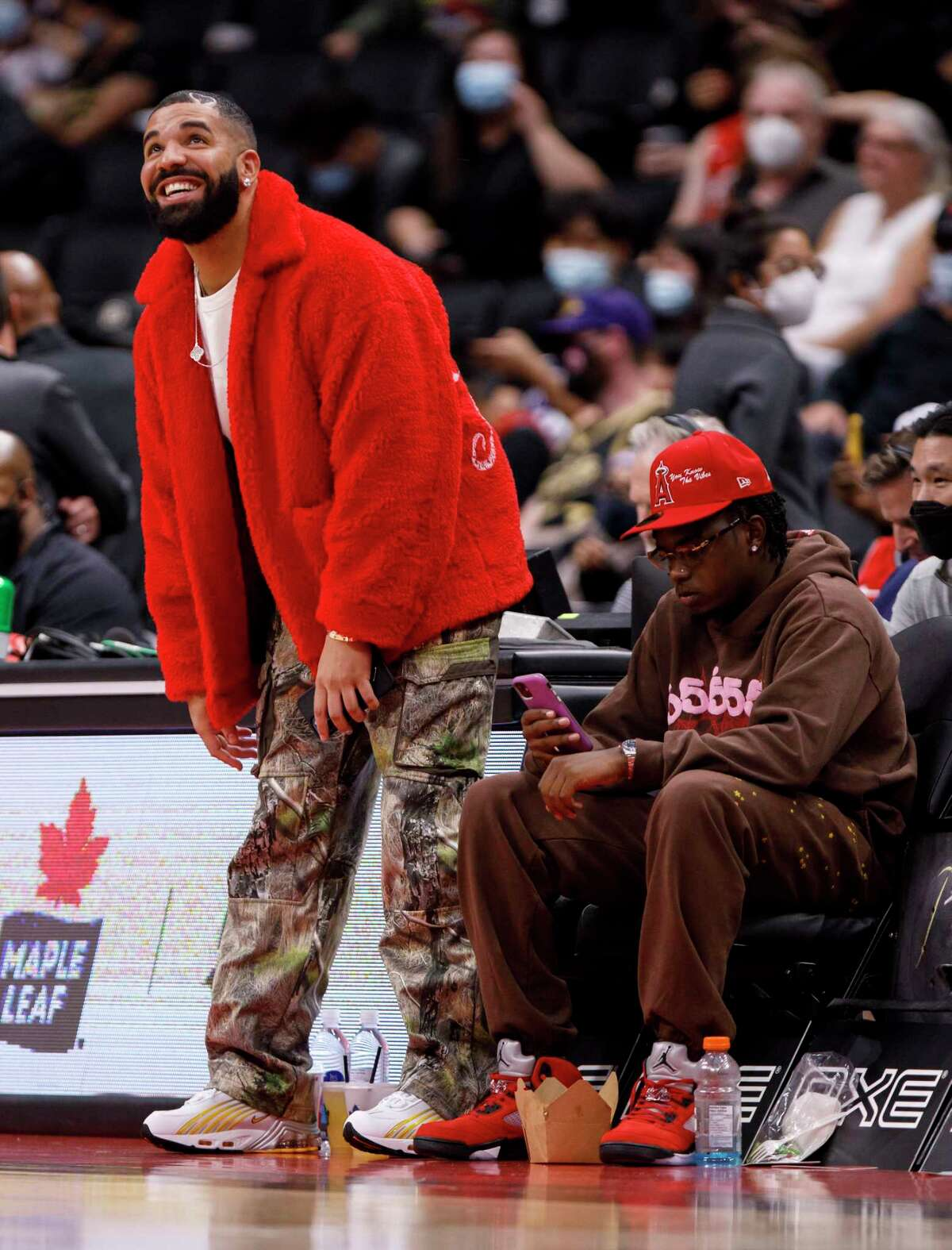 Drake attends a preseason NBA game between the Toronto Raptors and the Houston Rockets at Scotiabank Arena on October 11, 2021 in Toronto, Canada.