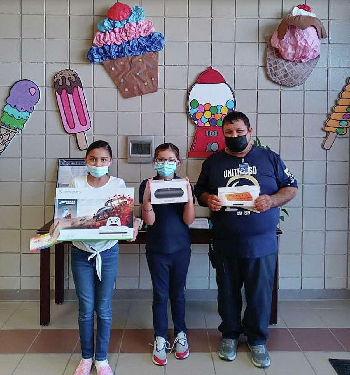 Pictured are Sophia Garza, Alexandria Rodriguez and Centeno Elementary School custodian Francisco Marquez.