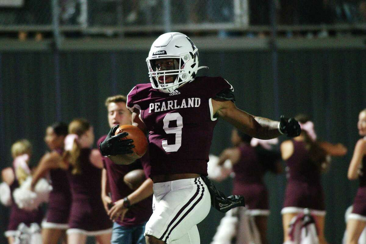 Pearland's Kennedy Lewis (9) finds running room against Alief Elsik Friday at The Rig.