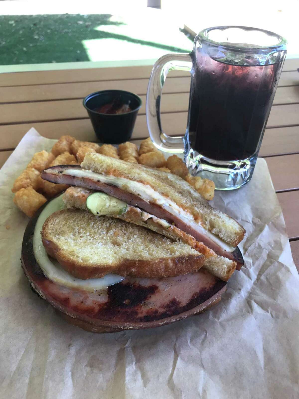 The Fried Mortadella Sandwich, spicy brown sugar tater tots and a Jones Grape Soda from Three Star Bar