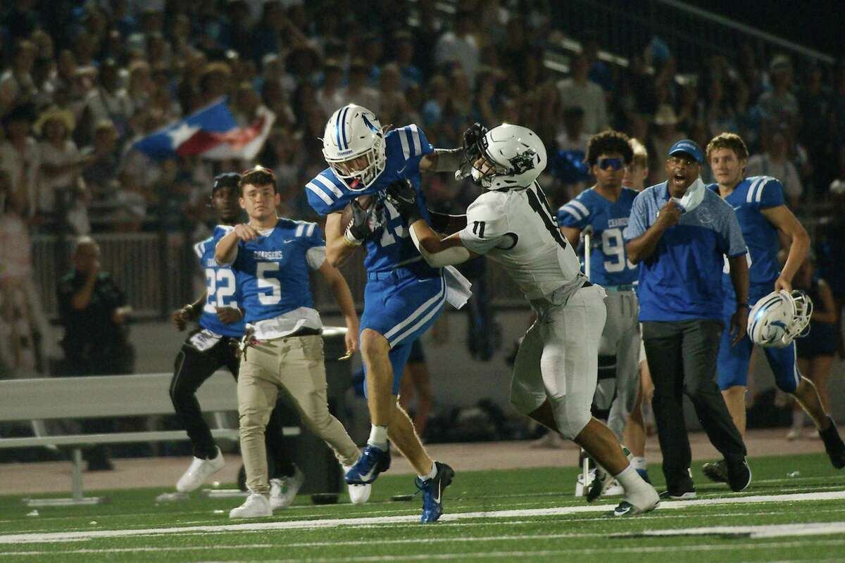 Clear Springs' Ashton Schumann (15) fights to break the tackle of Clear Falls' Keewan Grismore (11) Friday. Oct. 8, 2021 at Challenger Columbia Stadium.