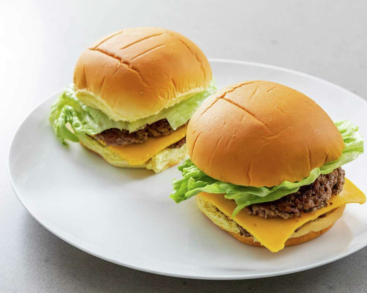 Smash burgers can be made at home using a very hot cast-iron or carbon steel skillet.