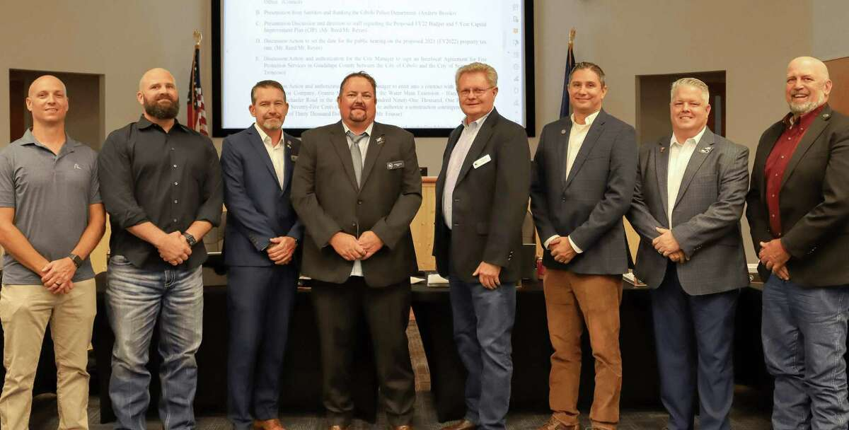 """New Cibolo District 1 City Councilman Terence """"T.G."""" Benson Jr. (far left) joins resigned-but-reinstated District 2 Councilman Steve Quinn (second from left) and the rest of council for a photo during their Sept. 14 meeting. From right are: Mayor Pro Tem Joel Hicks, District 7; Tim Woliver, District 6; Mark Allen, District 5; Ted Gibbs, District 4; Mayor Stosh Boyle; Reggie Bone, District 3; Quinn, and Benson."""