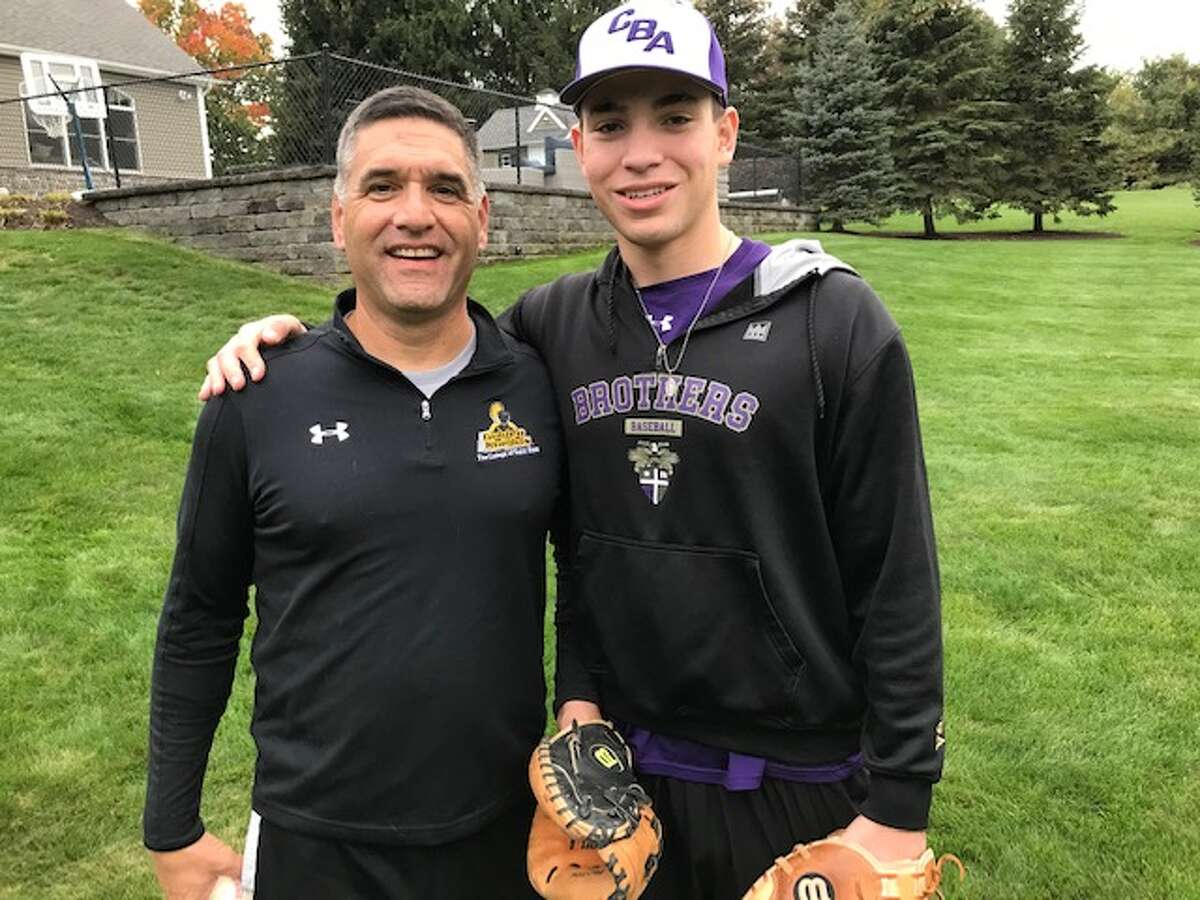 Gary Cohen with his son, Bennett, a CBA senior, who overcame brain tumor surgery and has committed to play baseball at The College of Saint Rose, where his father played baseball and his sister, Colette, plays softball. (Paul Grondahl / Times Union)