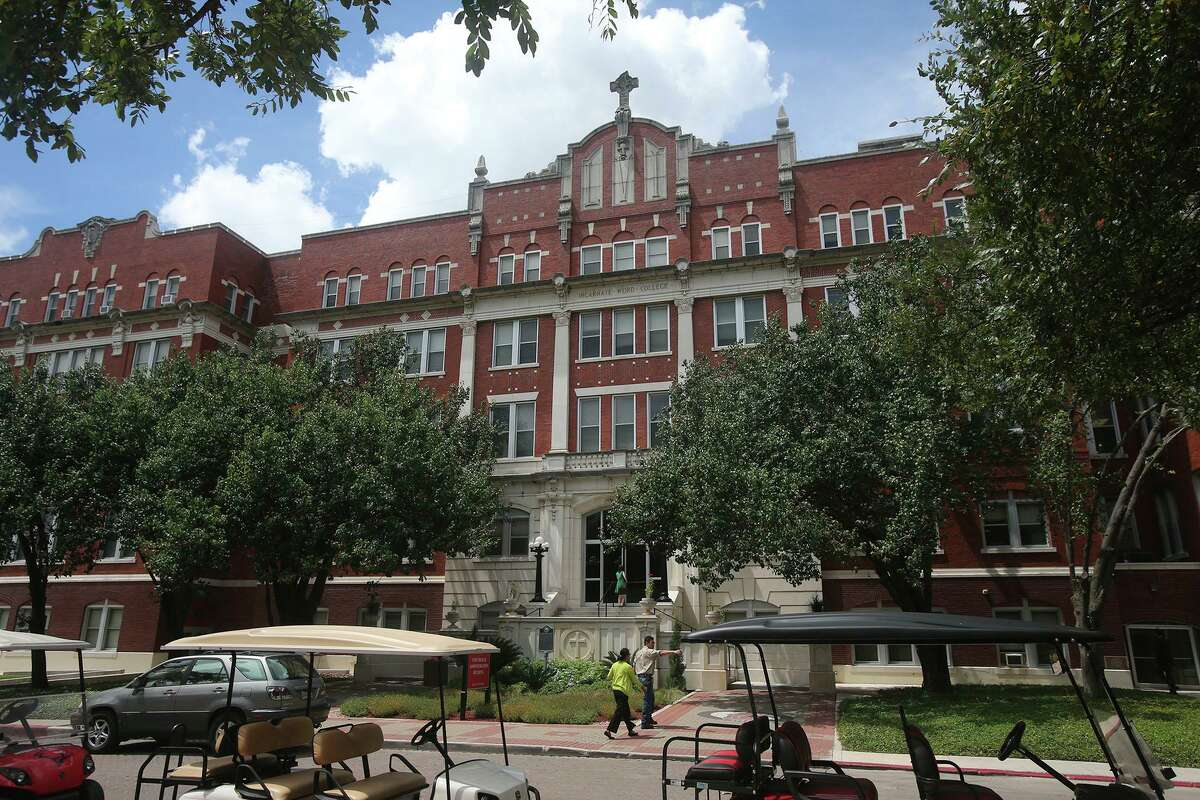 People walk through campus at the University of the Incarnate Word in 2016.