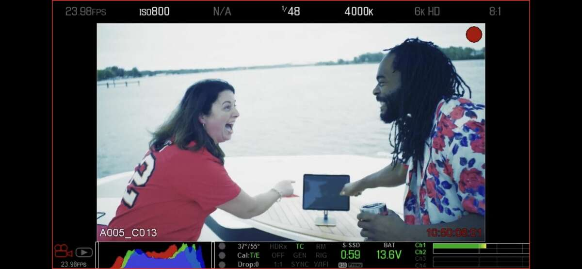 A screen shot from Chrissy Cavotta and an actor known simply as Simba filming a national TV spot with the NFL.