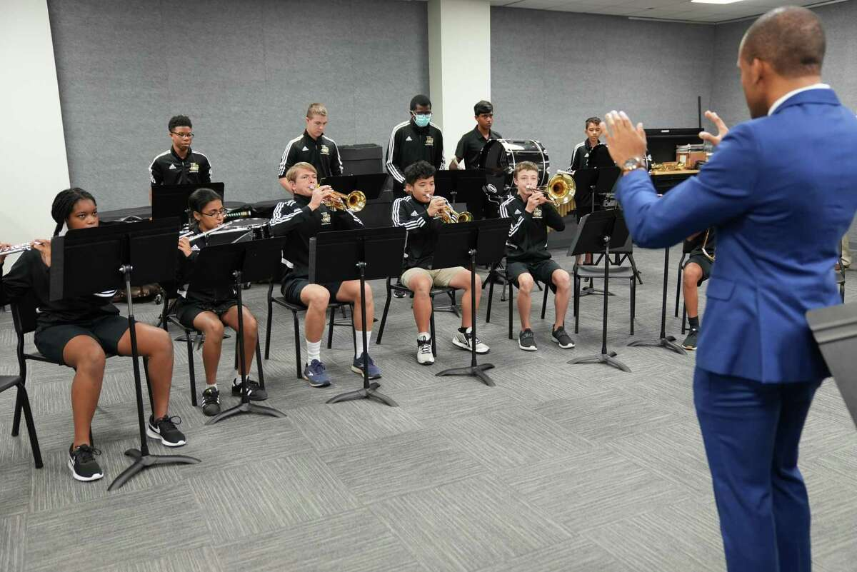 Members of the Fort Bend Christian Academy pep and performance bands perform during a ribbon-cutting for their new Edward Anthony Scala Sr. Band Room on Thursday, Sept. 30, in Sugar Land.