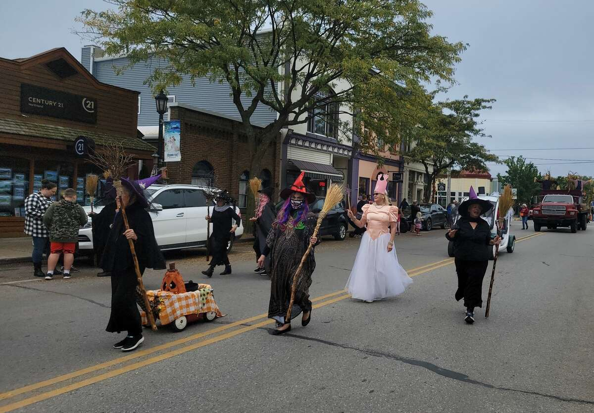 Some witches stroll down Frankfort's Main Street during the Fall Festival Parade