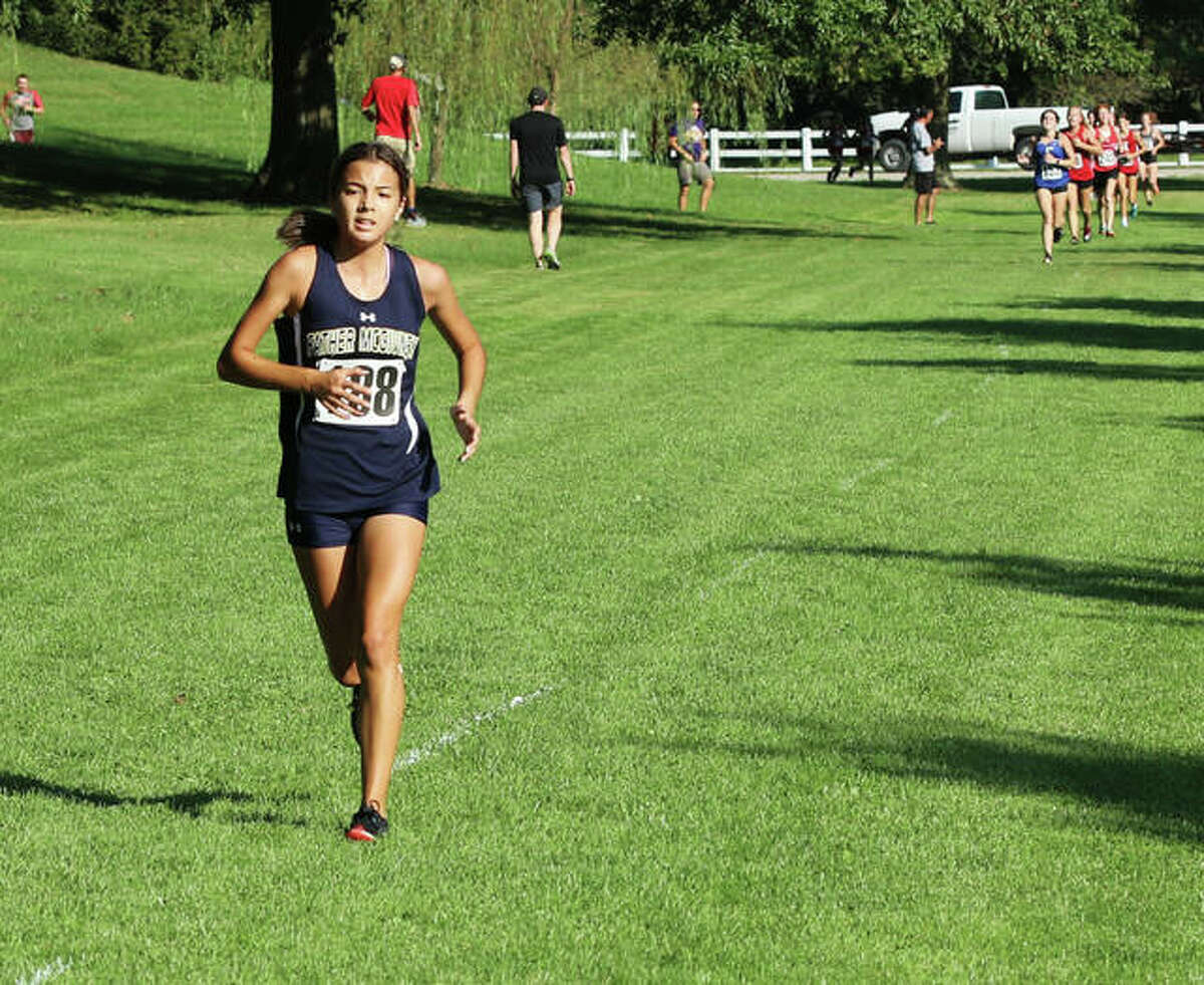 Father McGivney's Kaitlyn Hatley (left) separates from a pack of runners during the Highland Invite on Sept. 18 at Fireman and Legion Park in Alhambra.